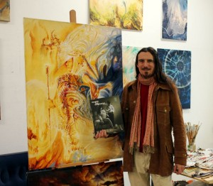 Leo Plaw in his studio with the book Imagine the Imagination