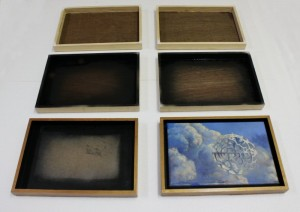 Picture frames built from recycled materials.
