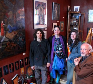 Kuba with visitors come to see his artwork.