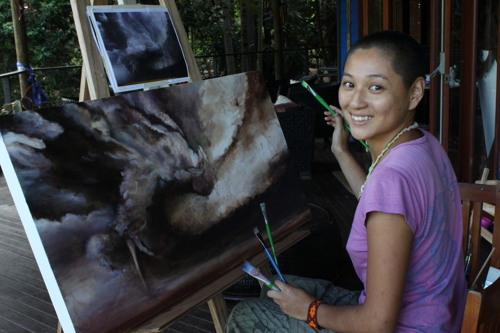 Yao working on her painting at Art in Paradise, Byron Bay